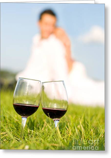 Two Wineglasses With Red Wine In Grass  Greeting Card by Arletta Cwalina
