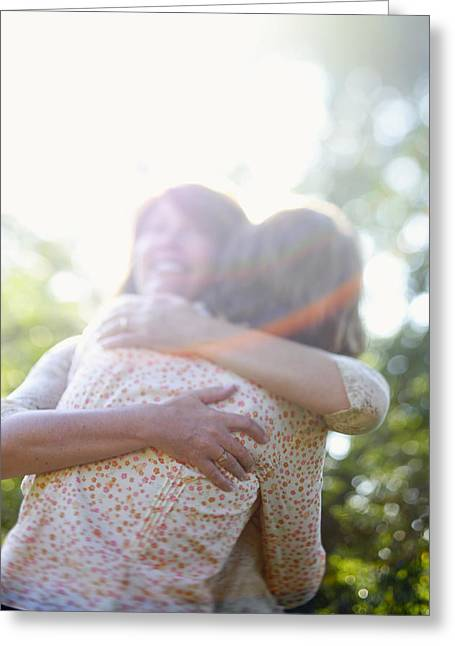 Two Women Hugging Each Other Greeting Card by Gillham Studios