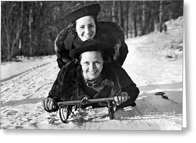 Two Young Women On A Sled Greeting Card