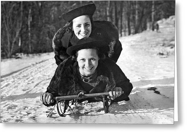 Two Young Women On A Sled Greeting Card by Underwood Archives