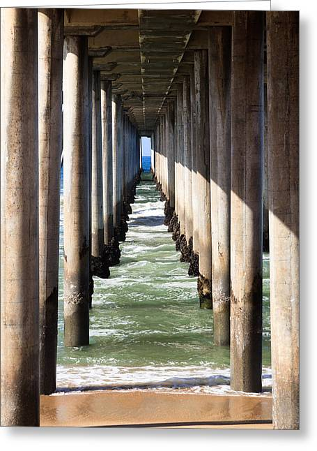 Ocean Beach Photos Greeting Cards - Under the Pier in Orange County California Greeting Card by Paul Velgos