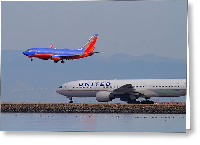 Landing Airplane Greeting Cards - United Airlines And Southwest Airlines Jet Airplane At San Francisco International Airport SFO.12087 Greeting Card by Wingsdomain Art and Photography