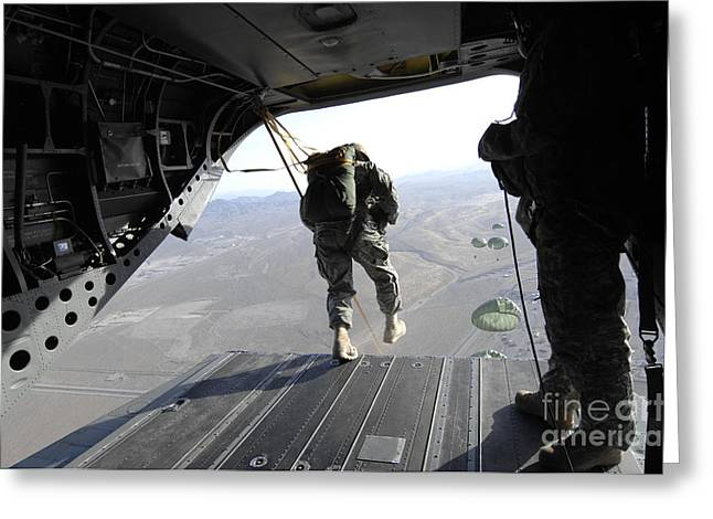 U.s. Airmen Jump From A Ch-47 Chinook Greeting Card by Stocktrek Images