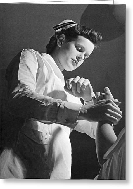 Us Navy Nurse Taking A Pulse Greeting Card by Underwood Archives
