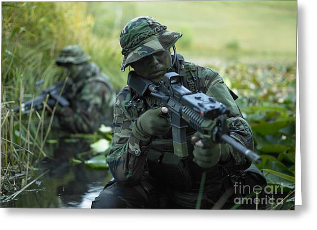 Jungle Warfare Greeting Cards - U.s. Navy Seals Cross Through A Stream Greeting Card by Tom Weber