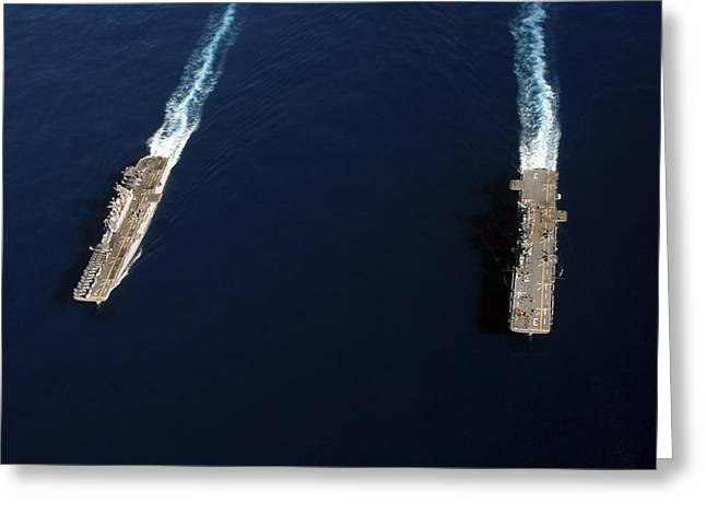 Carrier Greeting Cards - Uss Iwo Jima Steams Alongside Uss Greeting Card by Stocktrek Images