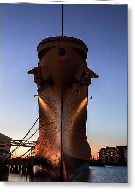 Uss Wisconsin Bow At Sunset Greeting Card by John Daly