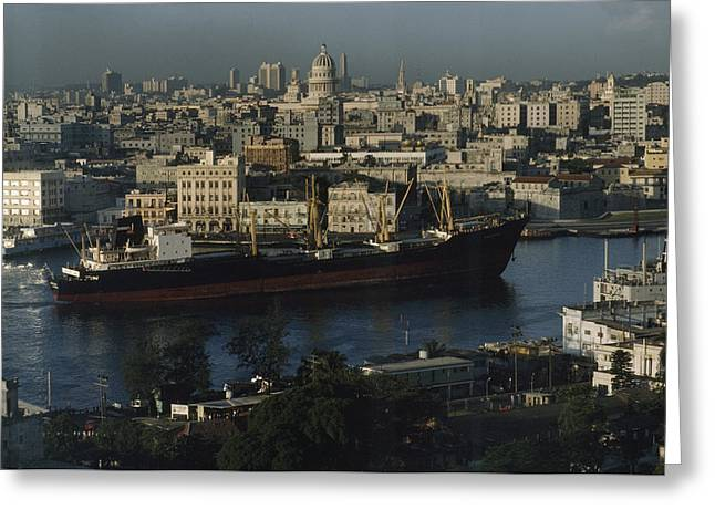 View Of City And A Massive Freighter Greeting Card by James L. Stanfield