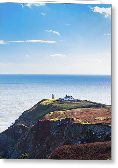View Of The Trails On Howth Cliffs With The Lighthouse In Irelan Greeting Card by Semmick Photo