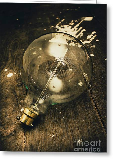 Vintage Light Bulb On Wooden Table Greeting Card by Jorgo Photography - Wall Art Gallery