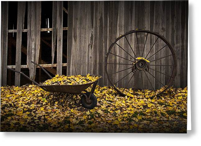 Wagon Wheel Rim And Wheel Barrel Covered With Fallen Autumn Leaves Greeting Card by Randall Nyhof