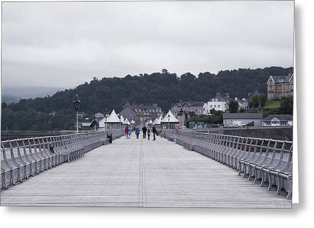 Walking On A Pier Greeting Card