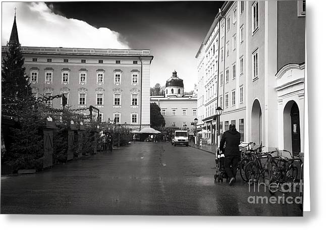 Walking The Baby In Salzburg Greeting Card by John Rizzuto
