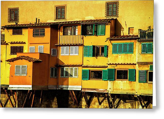 Greeting Card featuring the photograph Warm Glow On The Ponte Vecchio by Andrew Soundarajan
