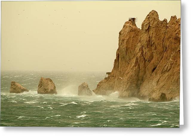 Weathered Rock Face Greeting Cards - Waves crashing on island on a stormy day Greeting Card by Sami Sarkis