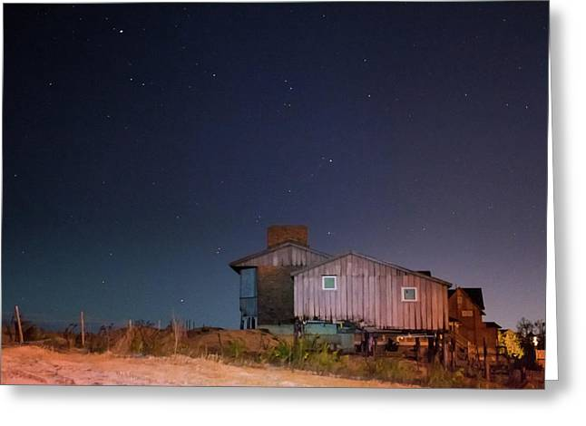 Weather Worn Beach House Against Starry Midnight Blue Sky Greeting Card
