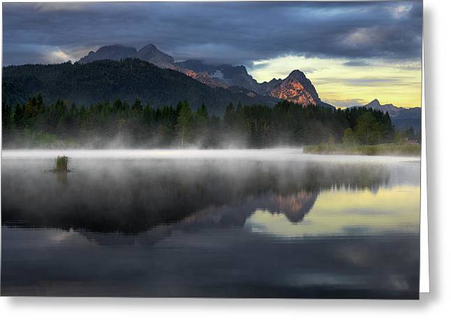Wetterstein Mountain Reflection During Autumn Day With Morning Fog Over Geroldsee Lake, Bavarian Alps, Bavaria, Germany. Greeting Card