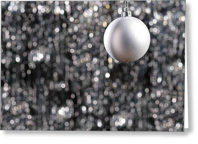 Greeting Card featuring the photograph White Christmas Bauble  by Ulrich Schade