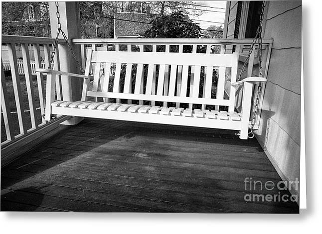 white wooden swing chair on a porch of a period home Boston USA Greeting Card