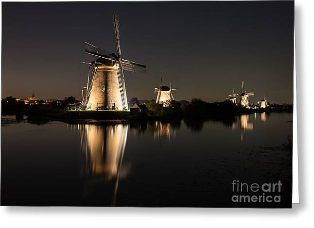 Greeting Card featuring the photograph Windmills Illuminated At Night by IPics Photography