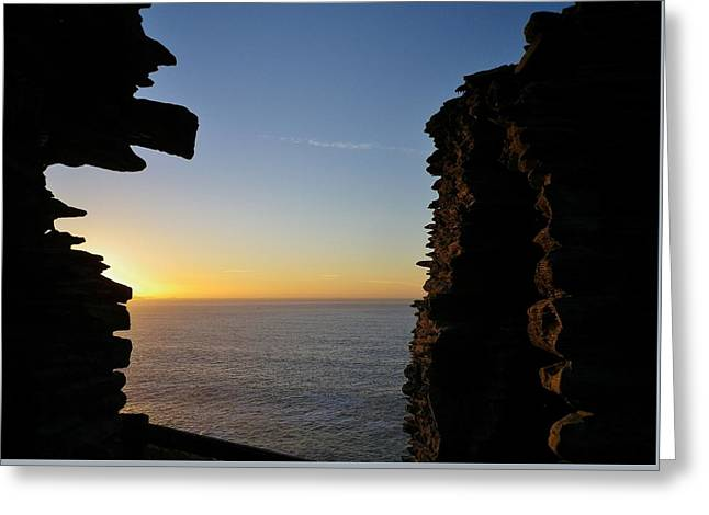 Winter Sunset At Tintagel Castle Cornwall Greeting Card by Richard Brookes