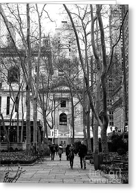 Winter Walk In Bryant Park Greeting Card by John Rizzuto