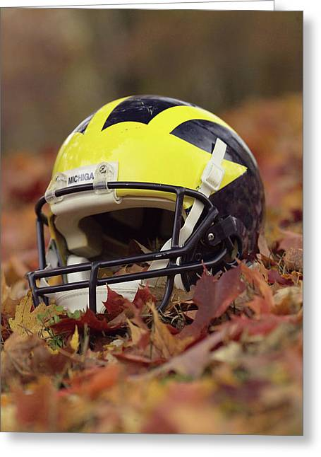 Greeting Card featuring the photograph Wolverine Helmet In October Leaves by Michigan Helmet
