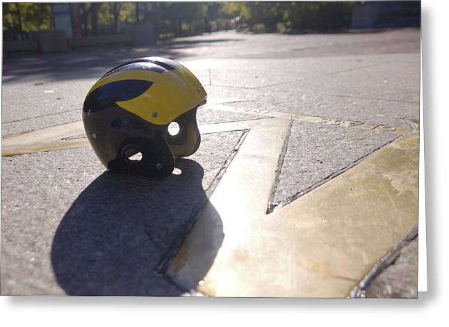 Greeting Card featuring the photograph Wolverine Helmet On The Diag by Michigan Helmet