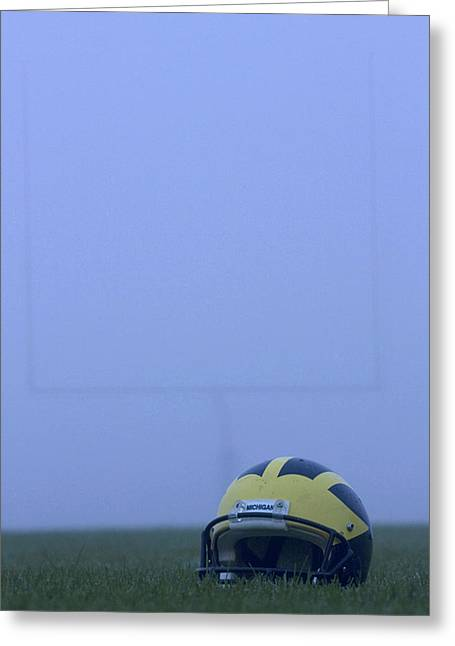 Greeting Card featuring the photograph Wolverine Helmet On The Field In Heavy Fog by Michigan Helmet