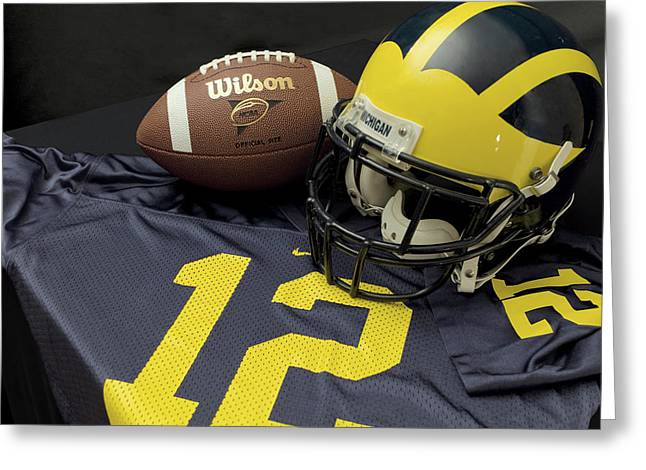 Wolverine Helmet With Football And Jersey Greeting Card