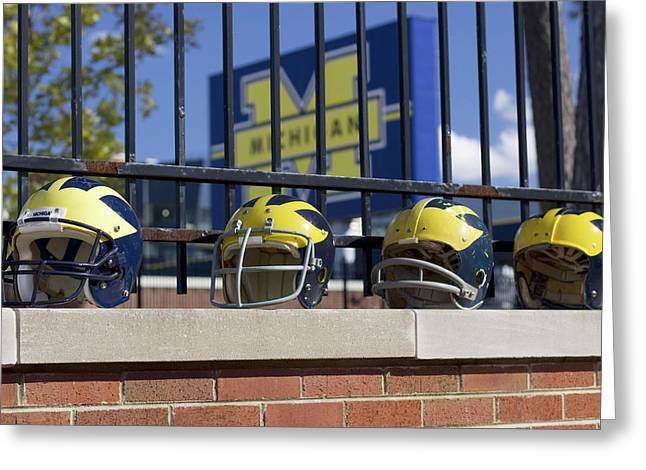 Wolverine Helmets Of Different Eras On Stadium Wall Greeting Card