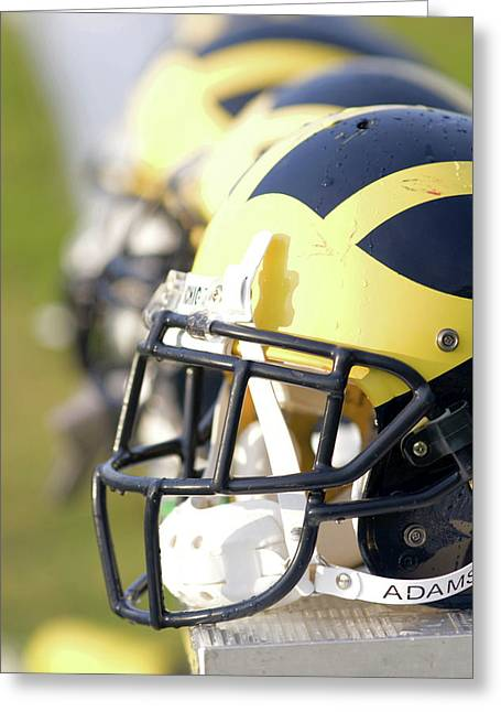 Greeting Card featuring the photograph Wolverine Helmets On A Bench In The Morning by Michigan Helmet