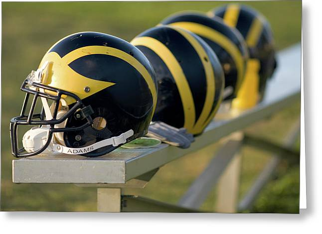 Greeting Card featuring the photograph Wolverine Helmets On A Bench by Michigan Helmet