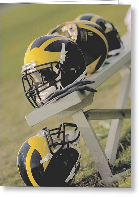 Greeting Card featuring the photograph Wolverine Helmets On A Football Bench by Michigan Helmet