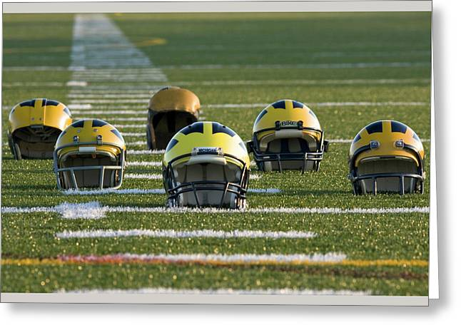 Greeting Card featuring the photograph Wolverine Helmets Throughout History On The Field by Michigan Helmet