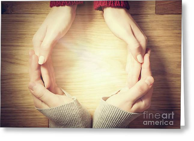 Woman And Man Making Circle With Hands. Warm Light Inside Greeting Card by Michal Bednarek
