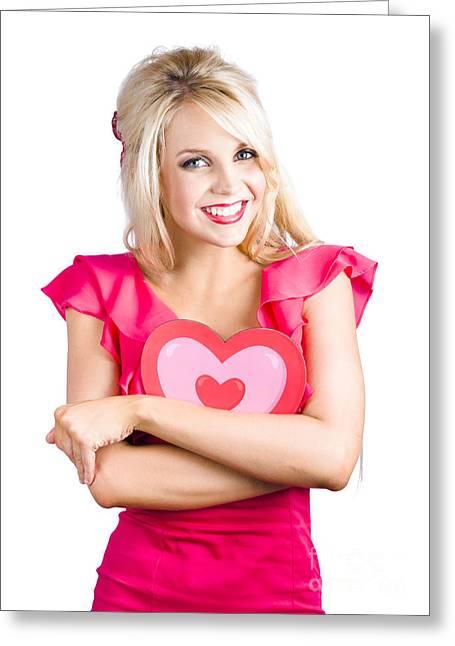 Woman Cuddling Love Heart Sign Greeting Card