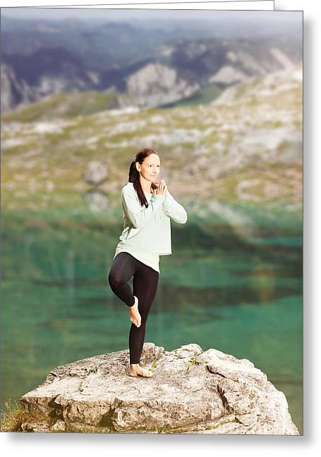 Woman Doing Yoga On A Rock On The Lake Shore Greeting Card