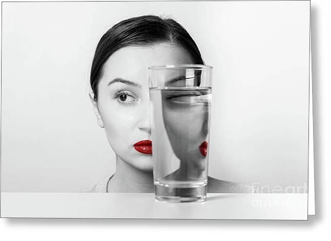 Woman Face Distortion In Glass Of Water Greeting Card by Radu Bercan