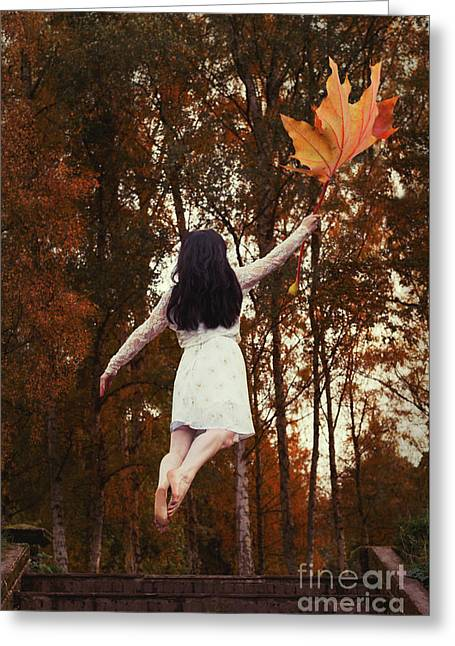 Woman Floating Away With Autumn Leaf Greeting Card