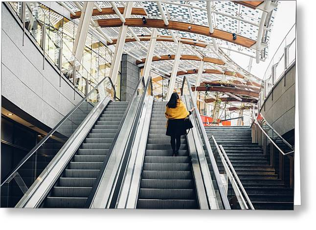 Woman Going Up Escalator In Milan, Italy Greeting Card