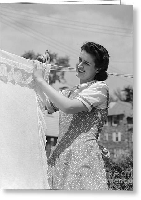 Woman Hanging Laundry Out To Dry Greeting Card by H. Armstrong Roberts/ClassicStock