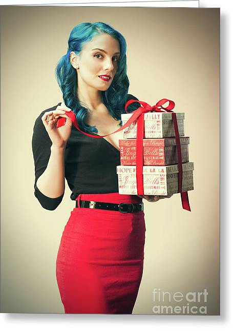 Woman Holding Christmas Presents Greeting Card