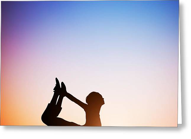 Woman In Bow Yoga Pose Meditating At Sunset Greeting Card by Michal Bednarek