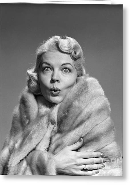 Woman In Fur With Surprised Look Greeting Card by Debrocke/ClassicStock