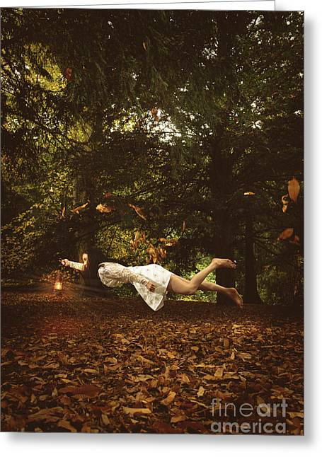 Woman Levitating Greeting Card