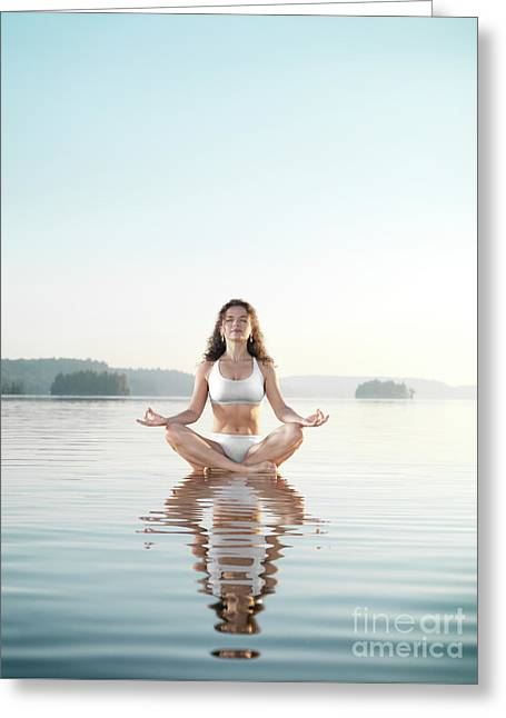 Woman Practicing Morning Sunrise Meditation On The Water Greeting Card