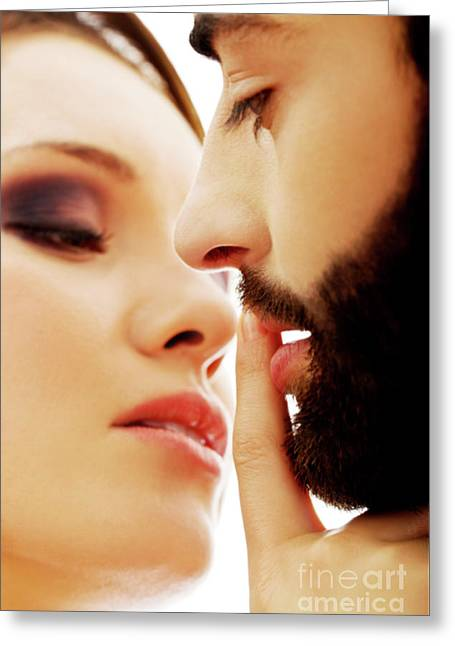 Woman Putting Her Finger On Man's Lips Greeting Card by Piotr Marcinski