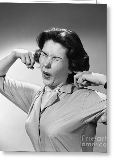 Woman Reacting To Loud Noise, C.1950s Greeting Card by H. Armstrong Roberts/ClassicStock