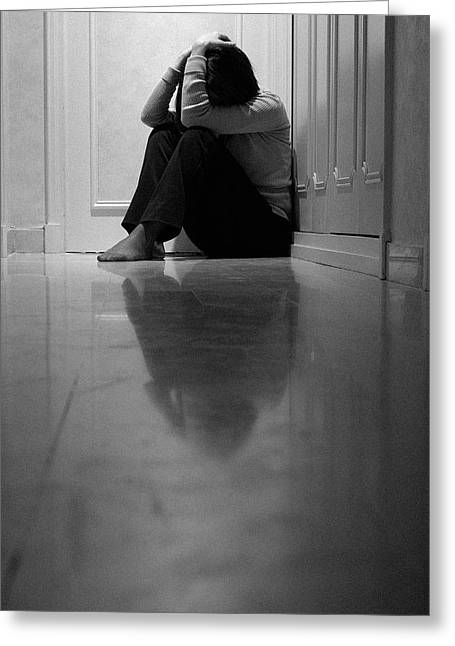 Best Sellers -  - Distraught Greeting Cards - Woman sitting in corridor with head in hands Greeting Card by Sami Sarkis
